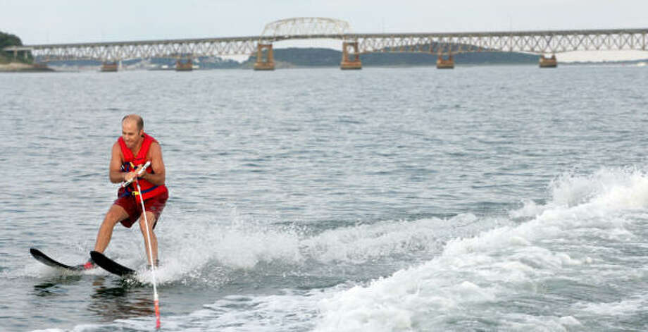 John Spiridakis is a member of an informal band of water-skiers called the Dorchester Bay Club that gathers on Boston Harbor every Wednesday. Photo: DOMINIC CHAVEZ, Boston Globe