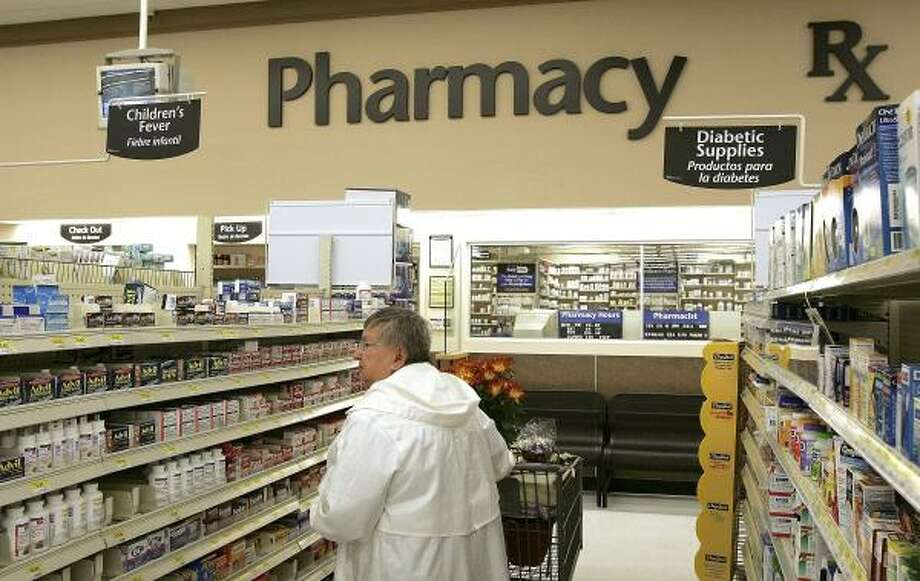 Barbara Hollowly shops in the pharmacy area of a Wal-Mart in Mount Prospect, Ill., on Thursday. The company plans to slash prices on almost 300 generic prescription drugs. Photo: Tim Boyle, Getty Images