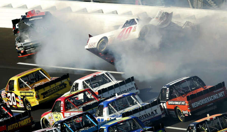 Mike Wallace, top left, and Derrike Cope (40) wreck on the last lap of the Craftsman Truck Series' race Saturday at Talladega. Photo: BUTCH DILL, AP