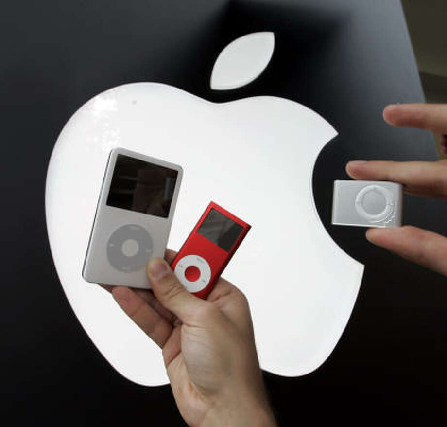 Apple's iPod Nano, left, and iPod Shuffle command the music player market. Rumor has it that Apple is poised to roll out the so-called iPhone, which would be a hybrid of a cell phone and iPod. Photo: PAUL SAKUMA, AP