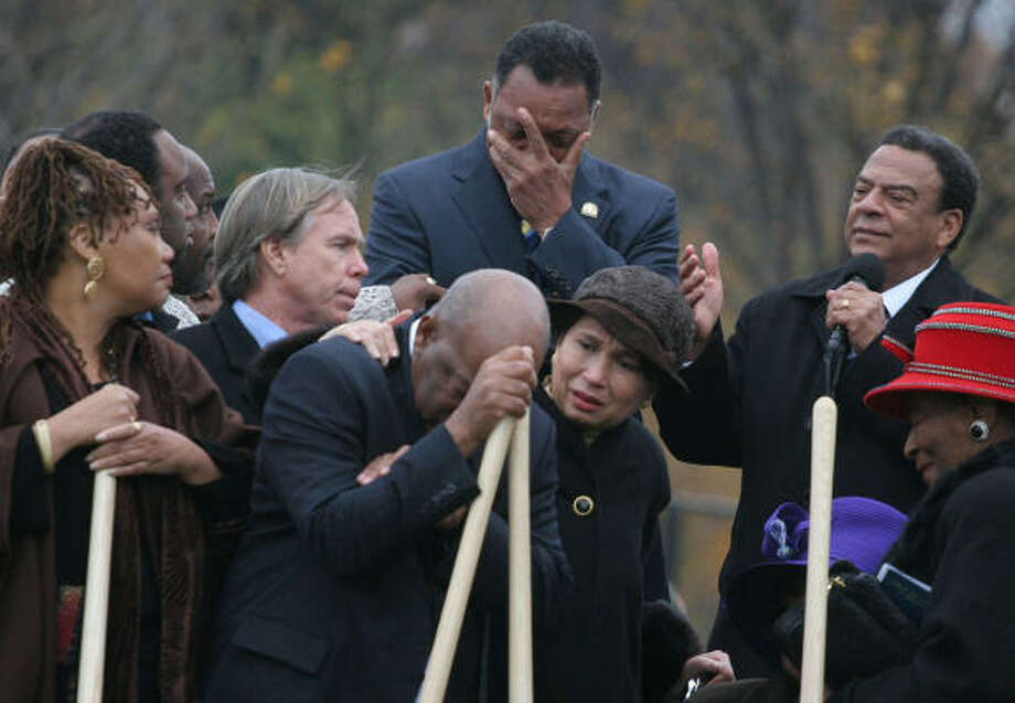 The Rev. Jesse Jackson and Rep. John Lewis, center, are overcome with emotion as Andrew Young, top right, talks about the Rev. Martin Luther King Jr. during the groundbreaking ceremony on Monday. Photo: LAUREN VICTORIA BURKE, AP