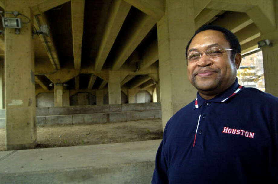 Louis Durden, program director for the Star of Hope, was homeless for 2 1/2  years, and sometimes slept under this Main Street bridge near the University of Houston-Downtown. Photo: Johnny Hanson, For The Chronicle