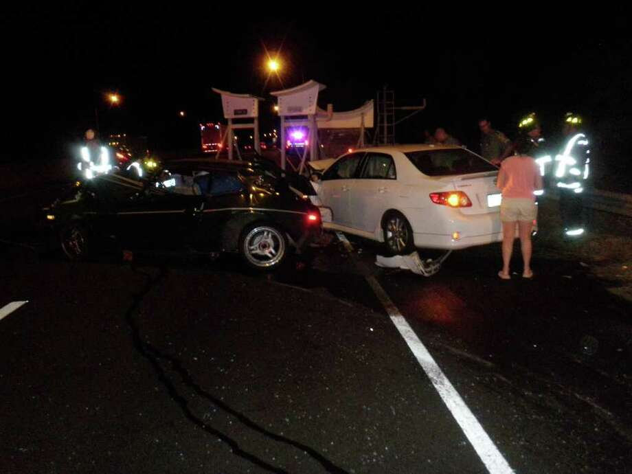 The scene of a collision between three vehicles -- one towing a sailboat trailer -- on Interstate 95 in Westport early Friday. Photo: Westport Fire Department / Westport News contributed