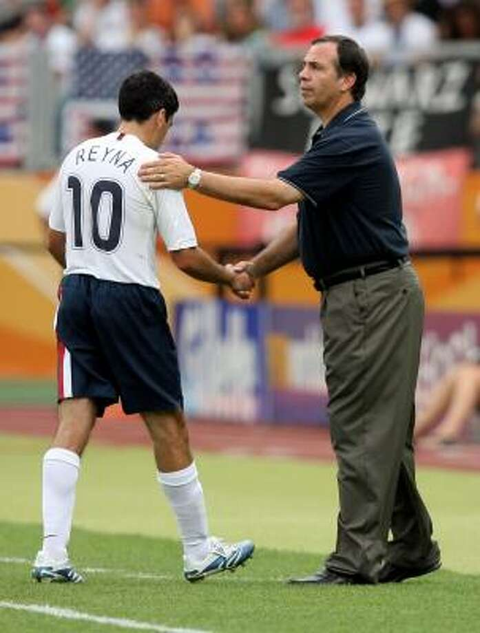 Claudio Reyna is consoled by coach Bruce Arena during the U.S. loss to Ghana. Photo: STU FORSTER, GETTY IMAGES