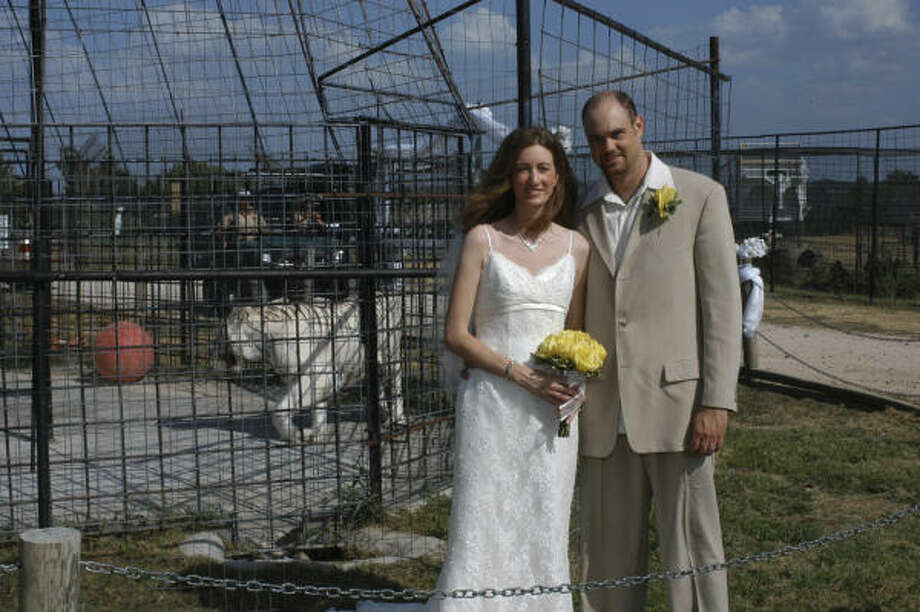 "Crystal Wood and Brian Hillerman got married at the Turpentine Creek Wildlife Refuge in Eureka Springs, Ark. They say it was just right for them to get married there. ""Instead of giving away our money, we were giving it back to something we believe in,"" Wood said. Photo: DENNIS L COLLINS, AP"