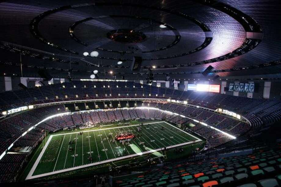 Lights at the Superdome — which 13 months ago was a shelter from Hurricane Katrina — are dimmed during preparations for Monday's game between the New Orleans Saints and the Atlanta Falcons. Photo: ALEX BRANDON, AP