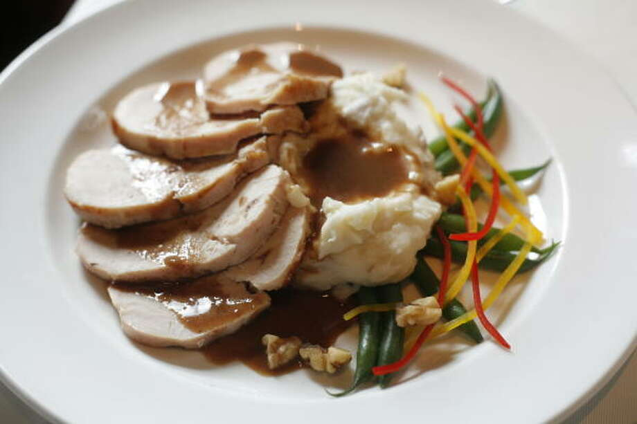 Although Arturo's Uptown Italiano offers variations on the Thanskgiving theme, including a la carte selections, its turkey plate with mashed potatoes and gravy and a vegetable medley will be available to diners who seek traditional fare. Photo: Steve Ueckert, Chronicle