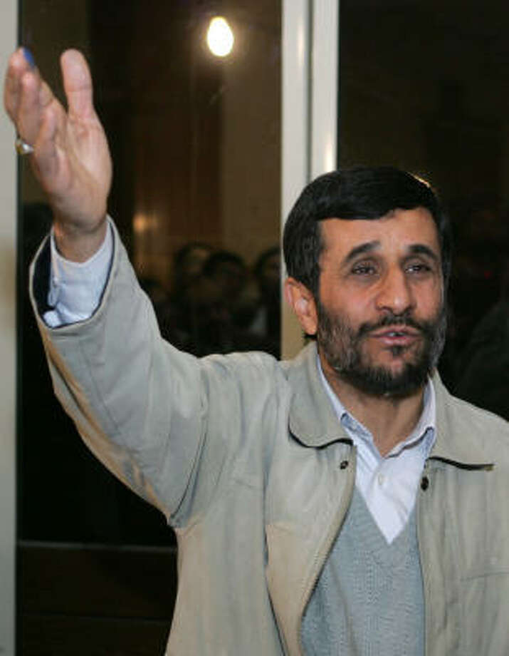 Iranian President Mahmoud Ahmadinejad speaks to the media after voting at a polling station in Narmak Grand mosque in Tehran on Friday. Iranians went to the polls in elections for municipal councils and the Assembly of Experts, the body that chooses the supreme leader, in the first test his since his election victory last year. Photo: BEHROUZ MEHRI, AFP/Getty Images