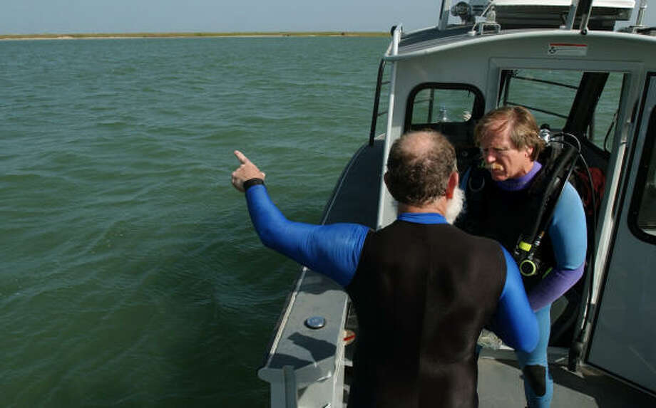 Glen Sayre, left, with the Southwest Underwater Archaeological Society, points out the location of the vessel on Monday to Steve Hoyt, a marine archaeologist with the Texas Historical Commission. Photo: MICHELLE CHRISTENSON, AP