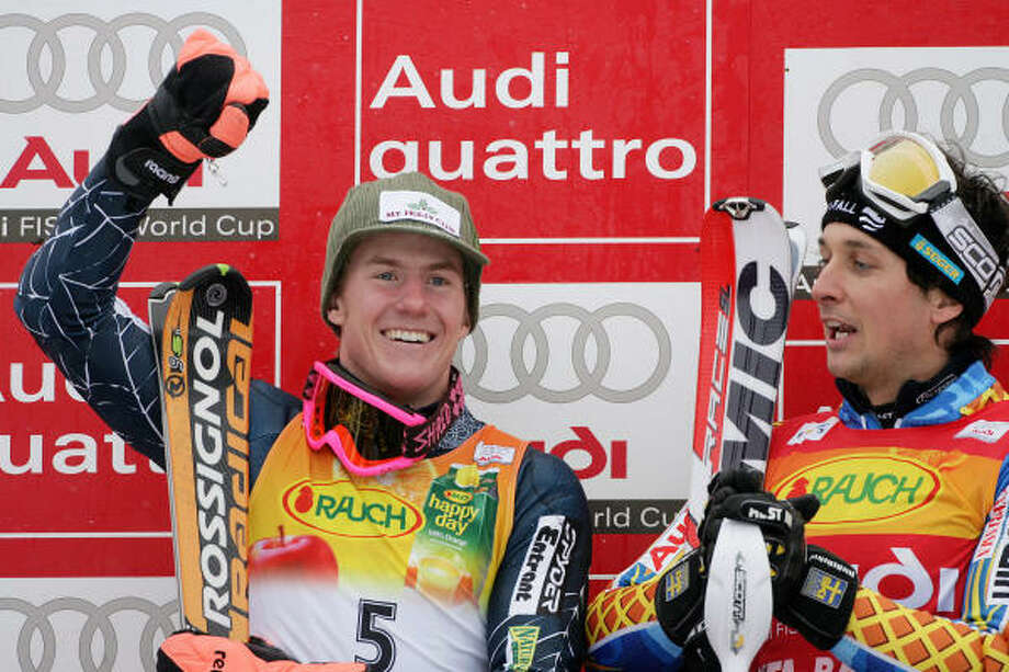 Second-place finisher Ted Ligety, left, celebrates with slalom winner Markus Larsson of Sweden after giving the Americans their fourth podium finish in as many days on Monday. Photo: VINCENZO PINTO, AFP/Getty Images