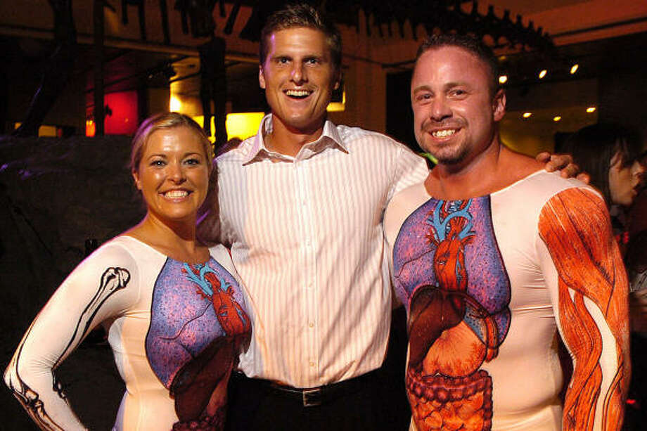 Houston Dynamo Zack Wells, center, enjoys the party with Jeni Bartling and Matt Trudo - aka Mr. and Ms. A. Natomy, dressed to promote the Body Worlds 3 exhibit - at the Houston Museum of Natural Science Mixers, Elixirs and IMAX soiree. Photo: Dave Rossman, For The Chronicle