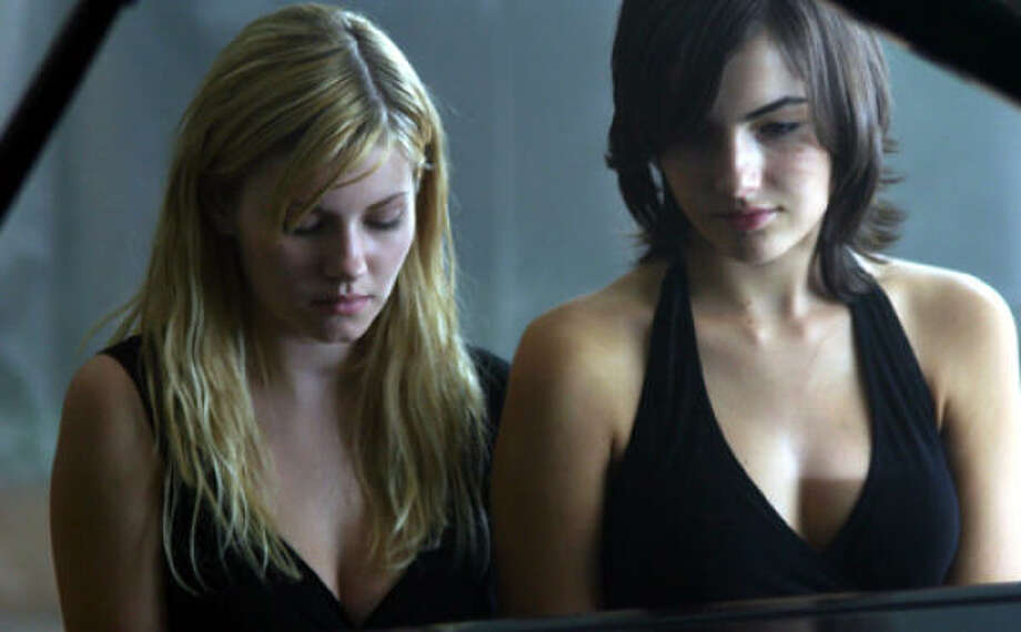 A cheerleader (Elisha Cuthbert, left) confides in her deaf adopted sister (Camilla Belle), in The Quiet. Photo: Sony Classics