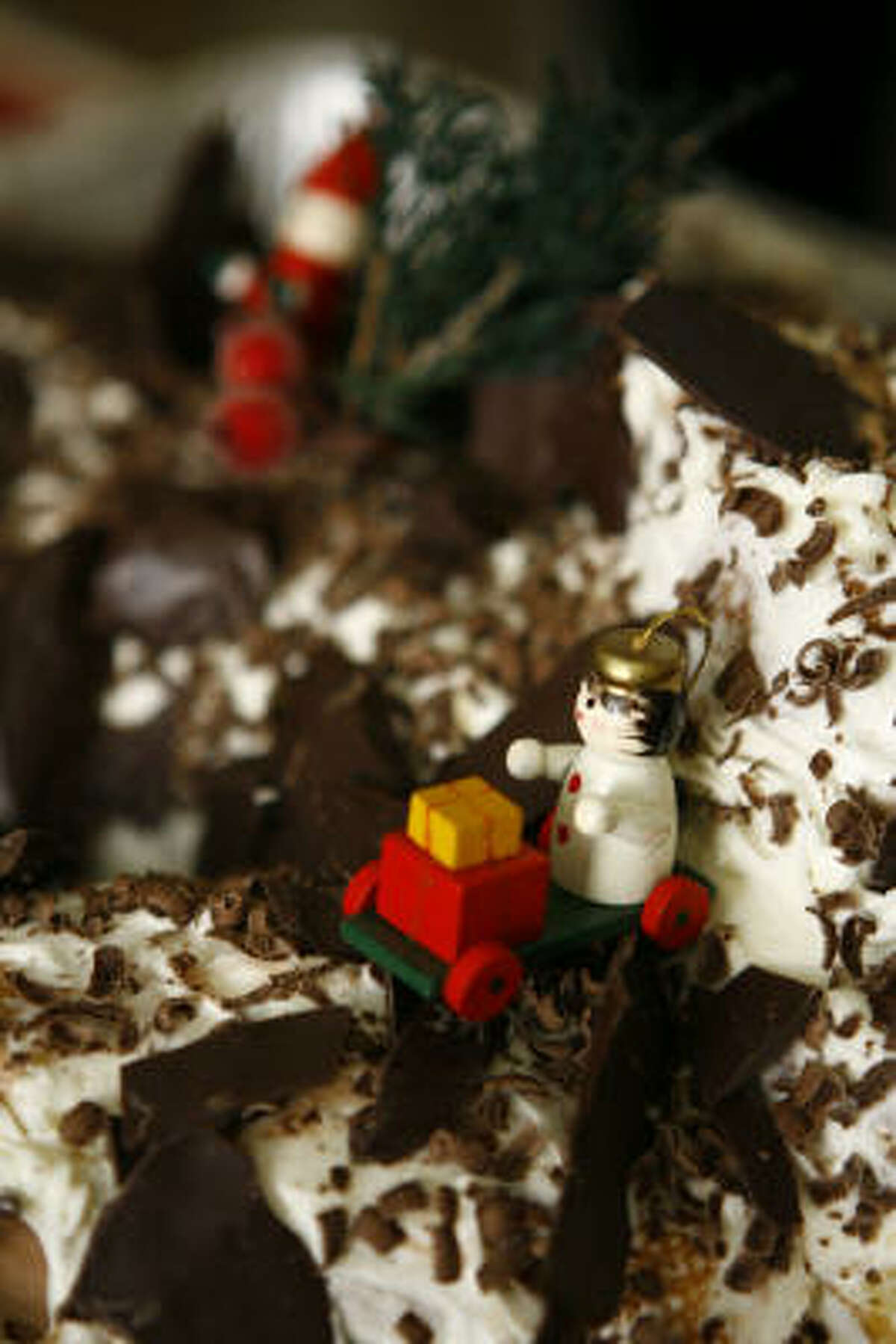 Bûche de Noël is filled with cream and fruit, then topped with chocolate.