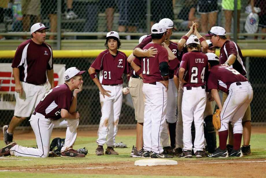 Pearland Maroon Little League team reacts after being eliminated in the title game of the Little League Southwestern Region Tournament by Lafayette Little League at Norcross Stadium Thursday, Aug. 11, 2011, in Waco. ( James Nielsen / Chronicle ) Photo: James Nielsen, Staff / © 2011 Houston Chronicle