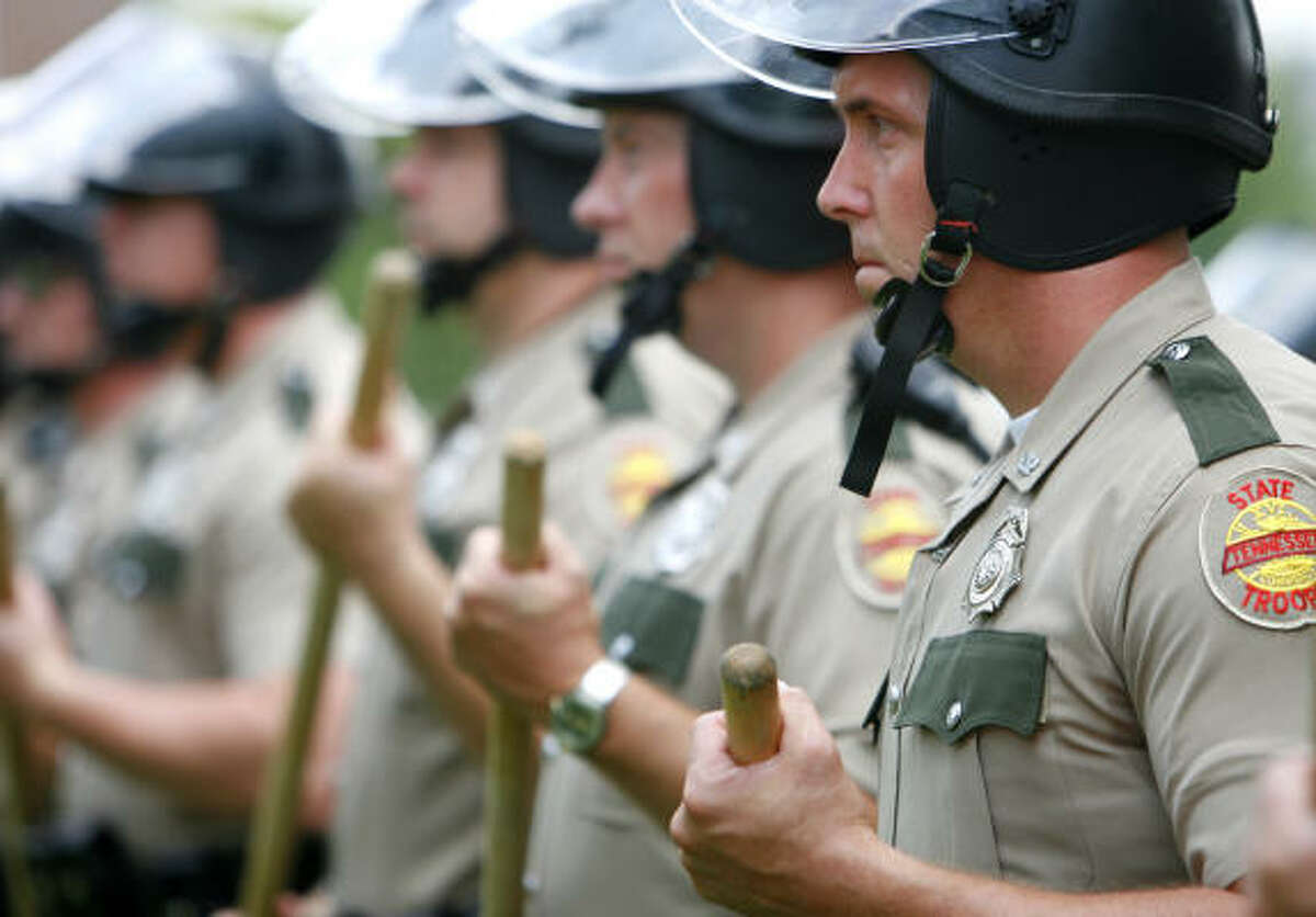 About 100 state and local officers stood guard at an anti-illegal immigration rally in front of the Hamblen County Courthouse in Morristown, Tenn., in June.