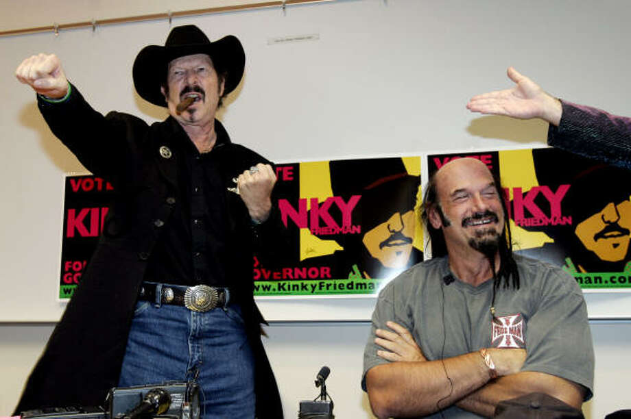 Former Minnesota Gov. Jesse Ventura, right, campaigns with Texas gubernatorial candidate Kinky Friedman on the campus of the University of Texas at San Antonio on Monday. Photo: ERIC GAY, AP