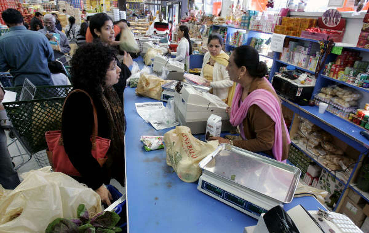 Aruna Rao, near left, shops at the Indian supermarket Apna Bazar Cash & Carry on Oct. 14 in Edison, N.J., in which roughly one-third of the population, like Rao, is of Asian Indian ancestry.