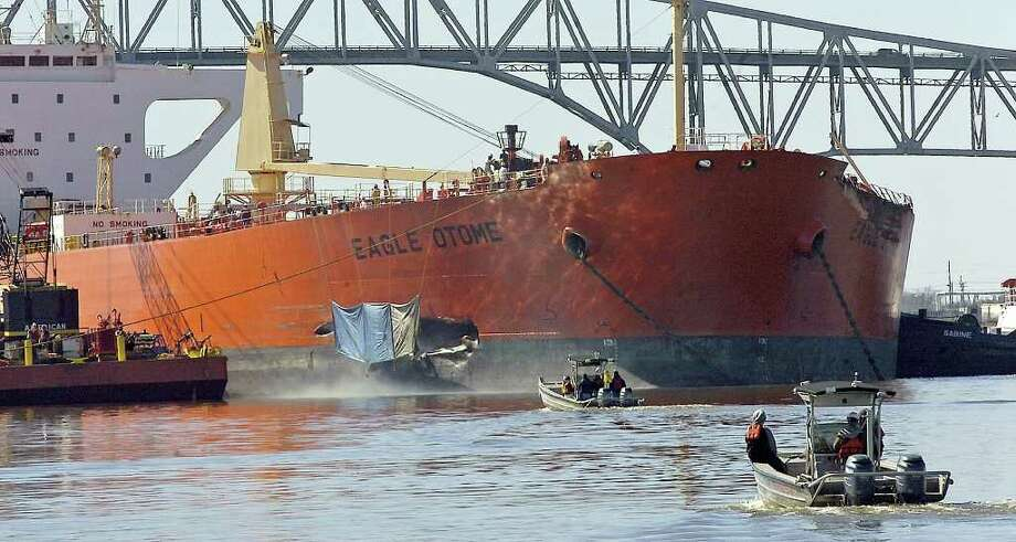 The Eagle Otome, holed just behind the bow from a collision with a barge, sits anchored in the middle of the Sabine Neches Waterway with emergency responders, oil spill specialists, and Coast Guard boats constantly patrolling after the collision in January 2010. Dave Ryan/The Enterprise / Beaumont