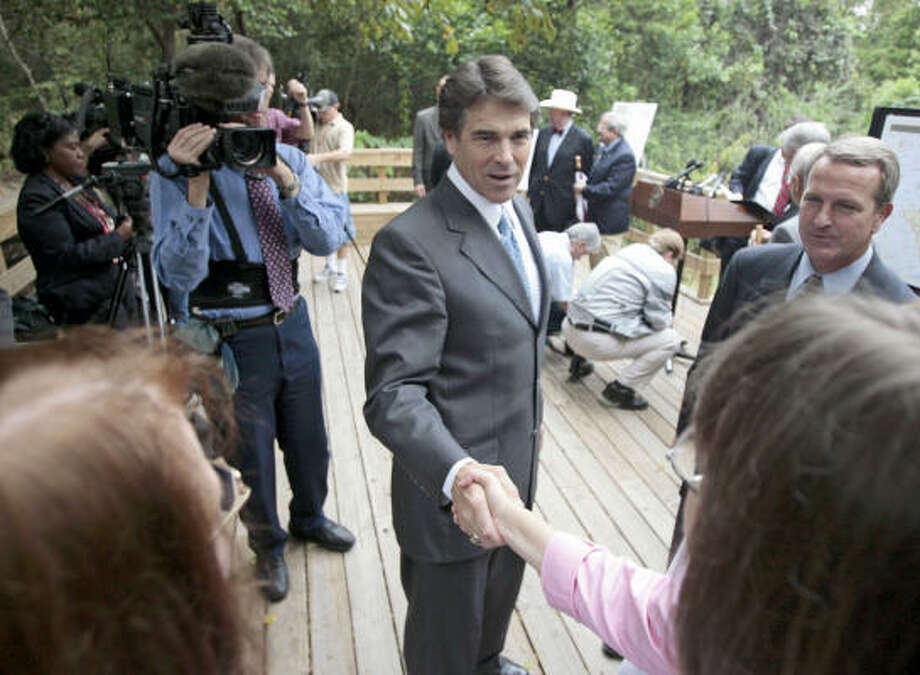Gov. Rick Perry shakes hands of employees of the Houston Arboretum and Nature Center. Photo: BILLY SMITH II, Chronicle