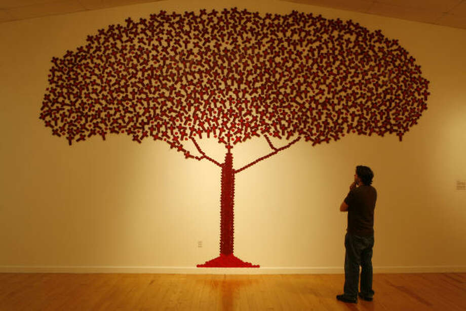Tree of Lifeby Angela Dillon features small, blood-red wooden crosses representing murder victims. Photo: Carlos Antonio Rios, Houston Chronicle