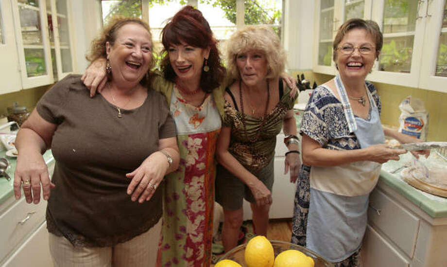 Argentines throughout: Toy Brando Halsey, right, aka the ñoquis queen, prepares the traditional meal with other Argentine expatriates, from left, Alicia Leichen, Lucy Keeper and Lucy Marzeniuk. Photo: Billy Smith II, CHRONICLE