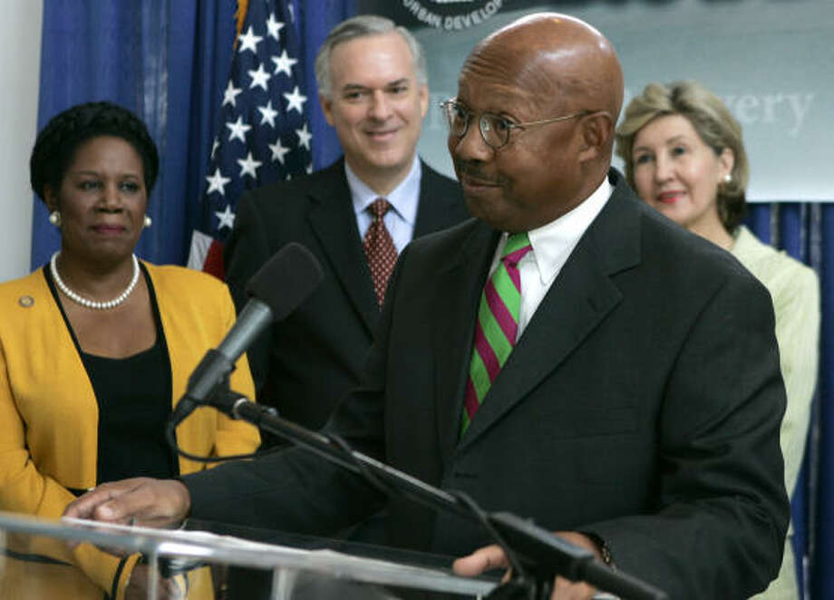 Housing and Urban Development Secretary Alphonso Jackson, foreground, speaks during Friday's Houston news conference as U.S. Rep. Sheila Jackson Lee, from left, Harris County Judge Robert Eckles and U.S. Sen. Kay Bailey Hutchison, share the stage. Photo: PAT SULLIVAN, AP