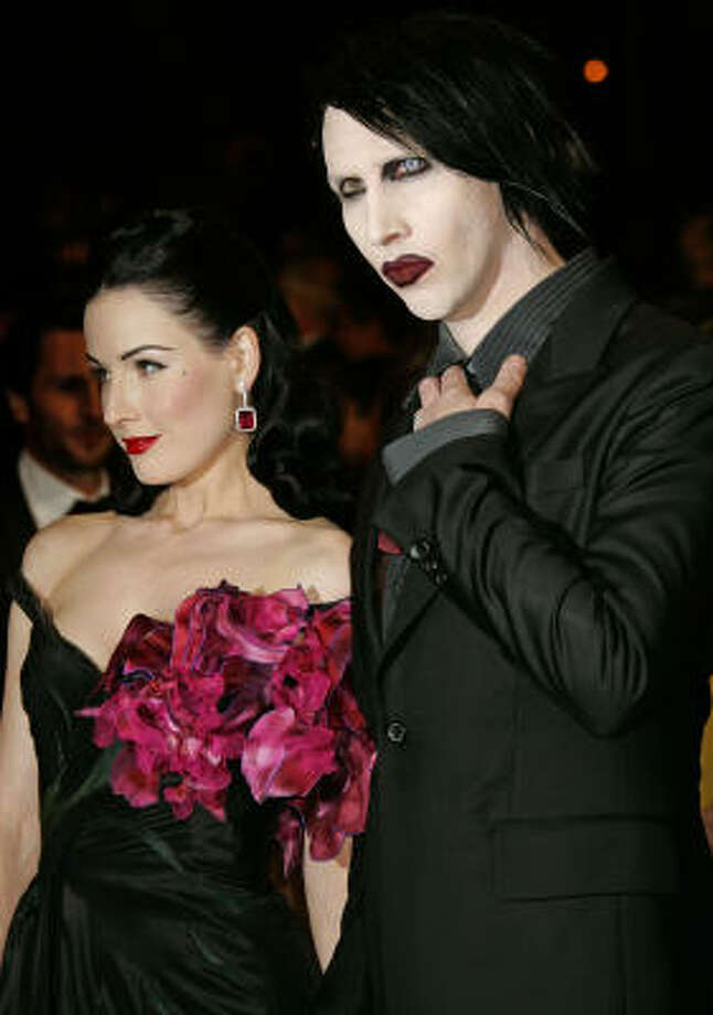 Marilyn Manson and then wife Dita Von Teese arrive for the screening of the film Southland Tales at the 59th International film festival in Cannes, southern France, on May 21, 2006. Photo: KIRSTY WIGGLESWORTH, AP File