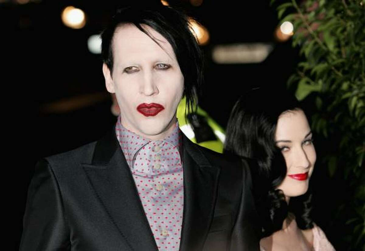 Marilyn Manson and Dita Von Teese attend the American & British Vogue London Fashion Week cocktail party at Luciano on Feb. 17, 2006, in London, England.