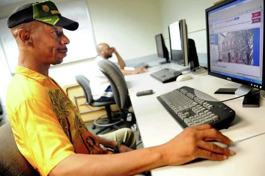 Veteran Alonzo Wiggins, a former resident at Homes for the Brave, uses the computer Wednesday, July 27, 2011 at the organization in Bridgeport, Conn. Photo: Autumn Driscoll / Connecticut Post