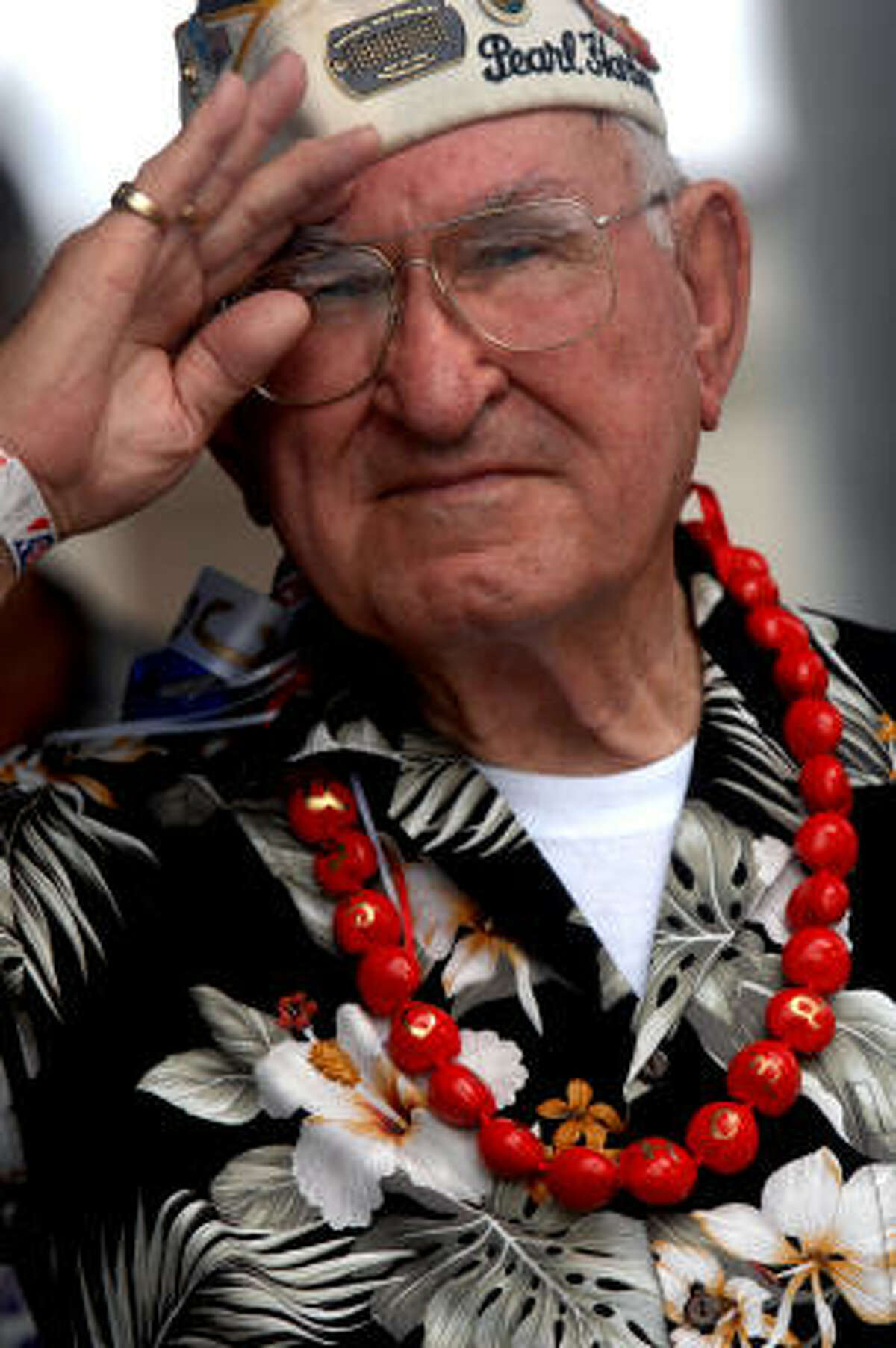Lewis Egnatovick, 86, of Lake City, Florida salutes during the commemoration marking the 66th anniversary of Pearl Harbor attack December 7, 2007 in Pearl Harbor, Hawaii.