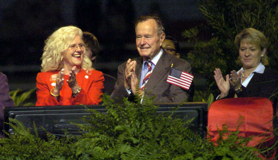 Diane Holland, right, with former President George H. W. Bush and Gretchen Fagan, right, mayor of Tomball, in 2007.  Photo: Jerry Baker, For The Chronicle