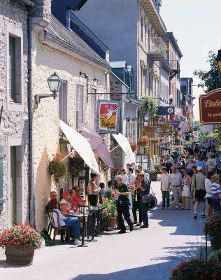 Sidewalk cafes line Petit-Champlain quarter in Quebec City. Photo: YVES TESSIER, Associated Press