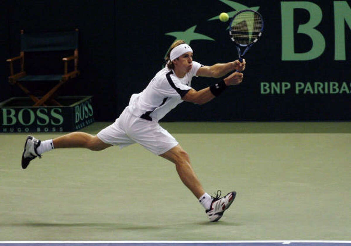 Russia's Igor Andreev returns a volley in the first set of a Davis Cup finals doubles match against the United States.