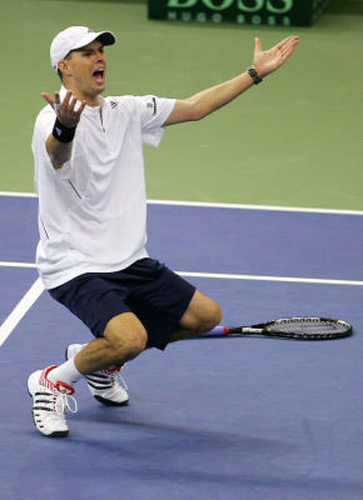 Mike Bryan celebrates his 7-6, 6-4, 6-2 victory with brother Bob Bryan over Igor Andreev and Nikolay Davydenko of Russia. Team USA defeated Russia 3-0 in the final.