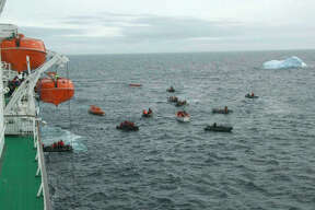 More than 150 passengers and crew took to lifeboats after the ship began taking on water through a hole in the hull.