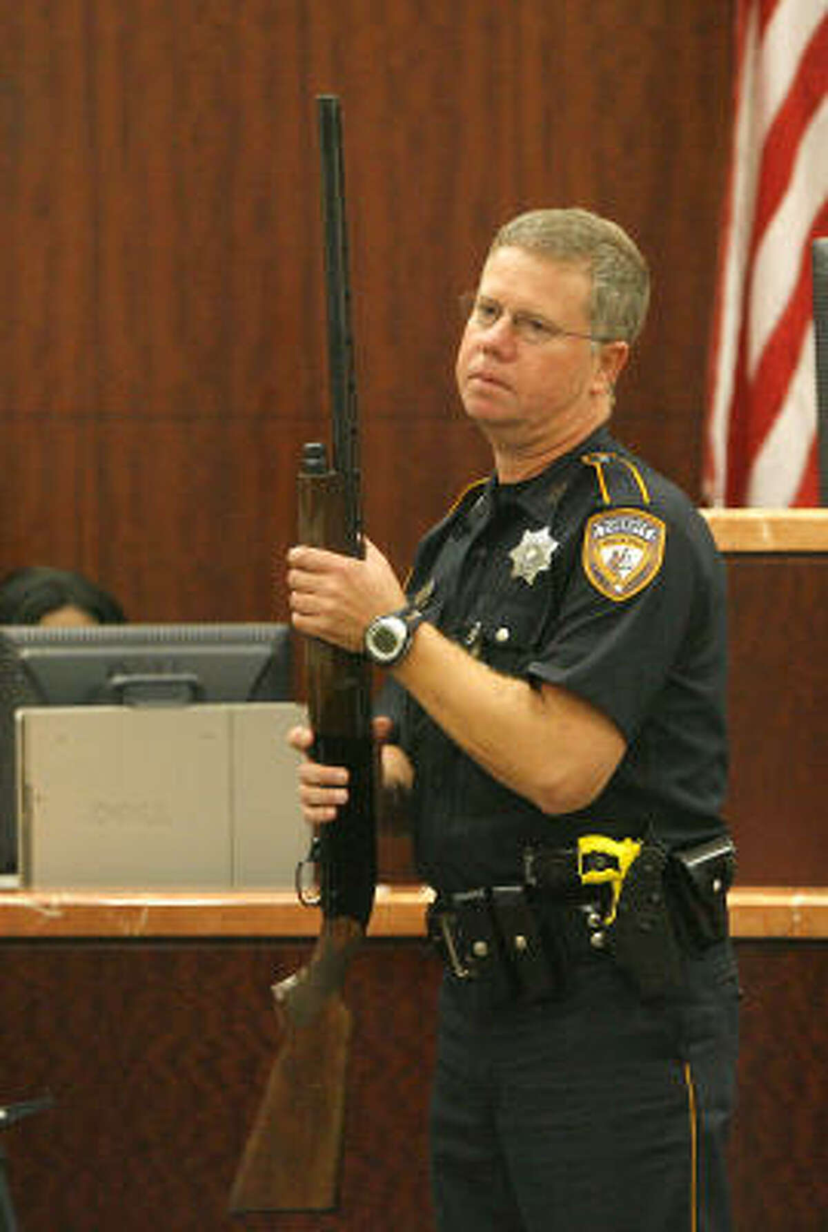 Bailiff H.T. Gilley takes charge of the shotgun that was used as evidence, Nov. 7.