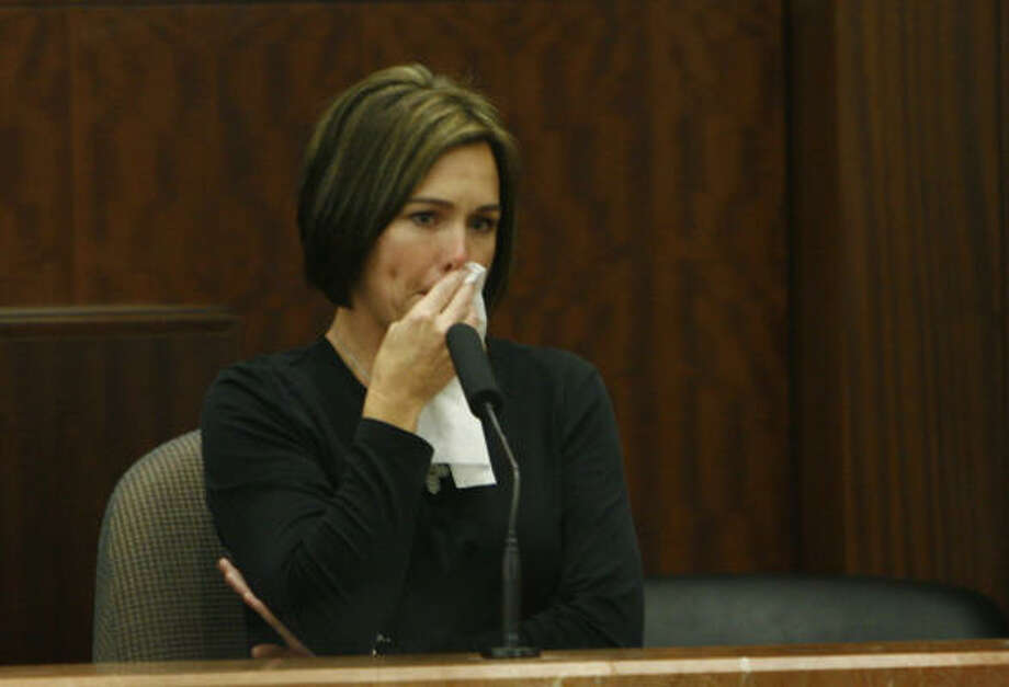 Tammy Harlan fights back her emotions, Oct. 24. Photo: Kevin Fujii, Chronicle