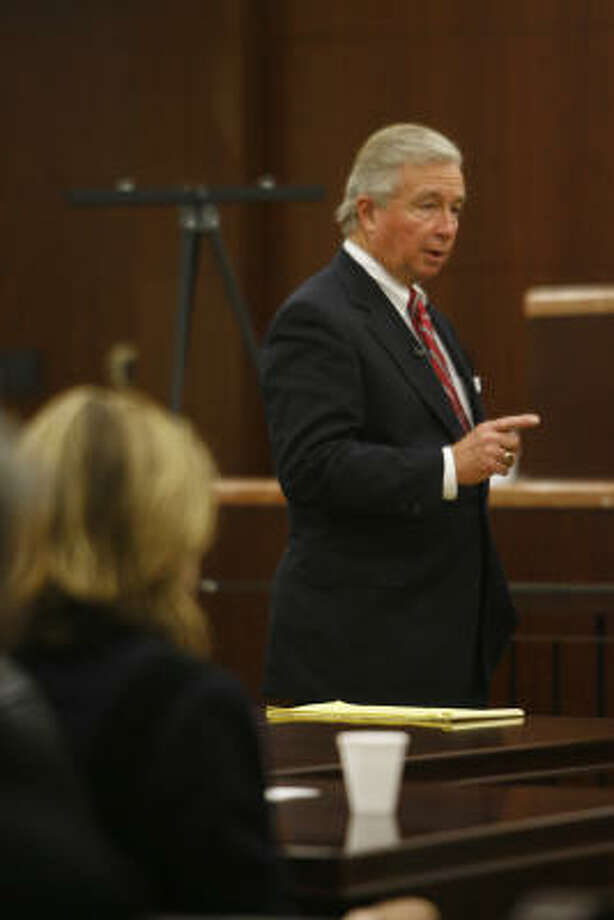 Harris County prosecutor Kelly Siegler listens to Dick DeGuerin's opening statement, Oct. 16. Photo: Kevin Fujii, Chronicle