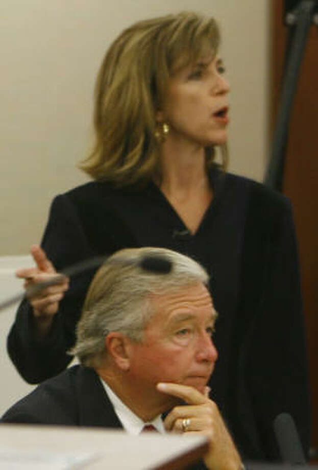 Harris County prosecutor Kelly Siegler addresses the jury Oct. 16 in her opening statement against David Temple, who is being defended by Dick DeGuerin. Photo: Kevin Fujii, Chronicle