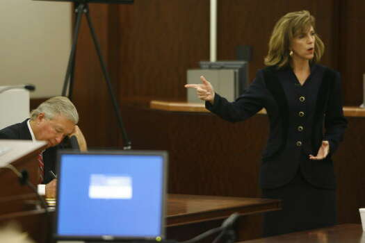 Defense attorney Dick DeGuerin writes notes as Harris County prosecutor Kelly Siegler addresses the jury in her opening statement, Oct. 16. Photo: Kevin Fujii, Chronicle