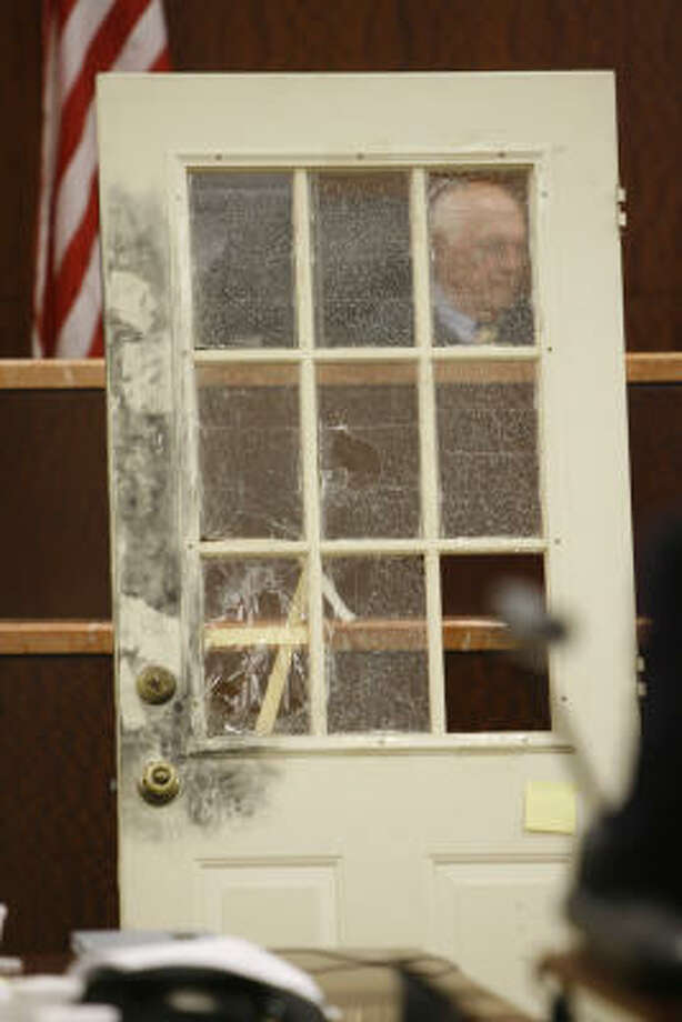 Judge Doug Shaver is visible Oct. 16 through the door where the point of entry was made for the alleged burglary to the Temple home. Photo: Kevin Fujii, Chronicle