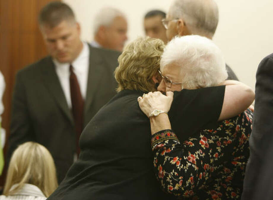 David Temple's mother, Maureen Temple, hugs a supporter after hearing the prosecution's opening statement, Oct. 16. Photo: Kevin Fujii, Chronicle