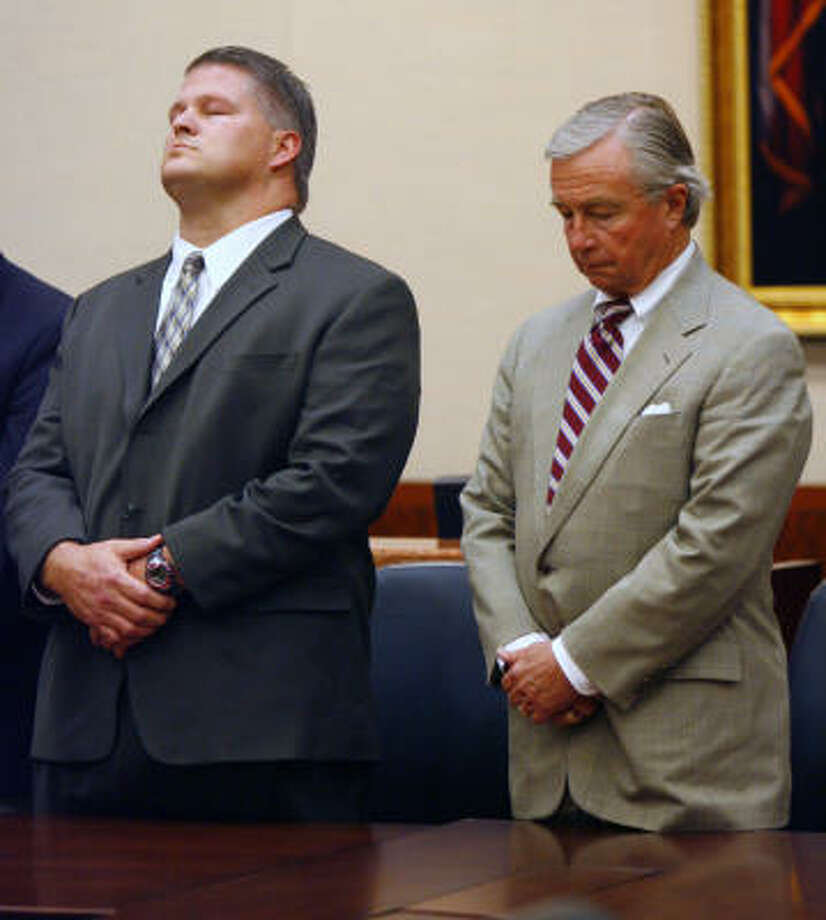 David Mark Temple (left), accused in the Jan 11, 1999 murder of his pregnant wife, Belinda Tracie Temple in their Katy home, standing next to his attorney, Dick DeGuerin, reacts as the Honorable Doug Shaver reads the jury's guilty verdict. Photo: Steve Ueckert, Chronicle