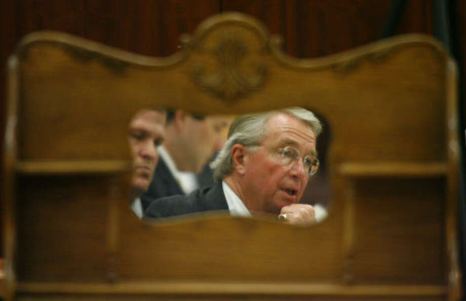 David Temple, left, and lead defense counsel Dick DeGuerin are reflected in the mirror of a hutch, which is evidence in the trial, Nov. 13. Photo: Steve Ueckert, Chronicle