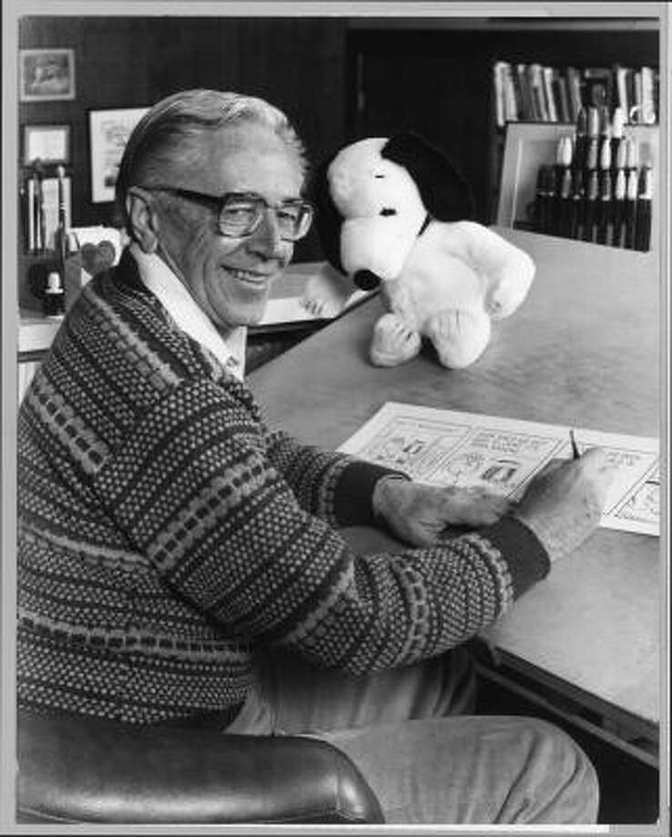Charles Schulz at work in 1987 with a