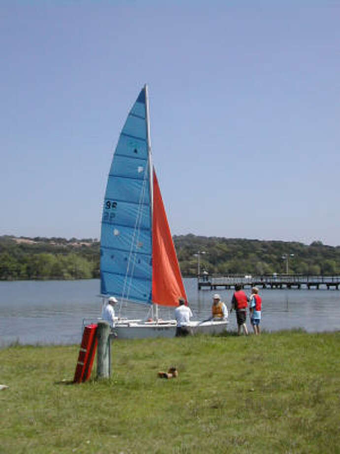 Park visitors prepare to sail a catamaran on Inks Lake. Photo: Catherine McIntosh, Chronicle