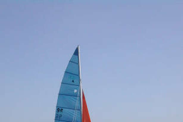 Park visitors prepare to sail a catamaran on Inks Lake.
