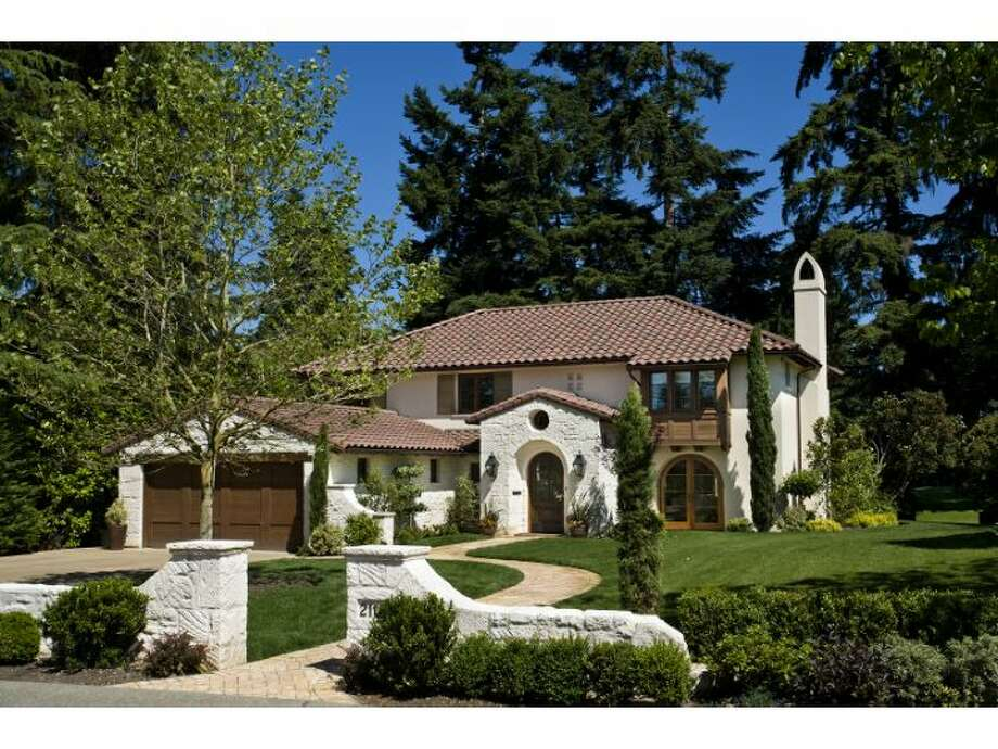 This Santa Barbara-style mansion, at 2110 Waverly Way East, sits on an 11,765-square-foot lot bordering the 12th fairway of the Broadmoor Golf Club. The exterior features a limestone-stucco facade, barrel-tile roof and brick patio. Inside, you'll find arched passageways, a limestone fireplace, French doors, oak floors, four bedrooms, four bathrooms and a media room. It's listed for $4.749 million (listing: www.windermere.com/index.cfm?fuseaction=listing.listingDetailUpdated&listingID=130499530) Photo: Windermere Real Estate