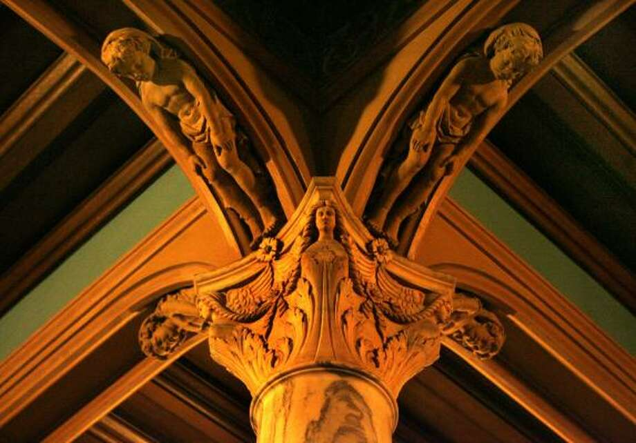As visitors walk through the dim hallways and the grand atrium in the center of the Julia Ideson Building, architectural relief sculptures on the tops of columns add to the mystique of the facility. The building is said to be haunted by a violin-playing ghost. Photo: Carlos Antonio Rios, Houston Chronicle