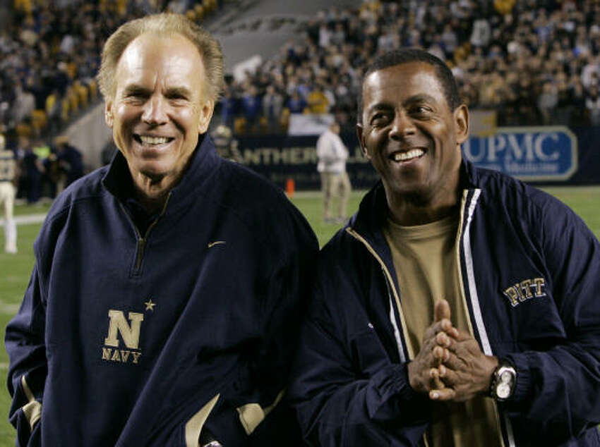Former Navy quarterback Roger Staubach, left, and former Pittsburgh running back Tony Dorsett are honorary captains for Wednesday's game between the Midshipmen and Panthers at Pittsburgh. Staubach's Navy team won 48-45 in double overtime.